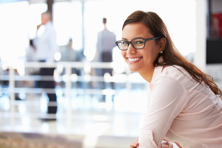 corporate business: Portrait of smiling woman in office