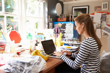 small home: Woman On Laptop Running Business From Home Office