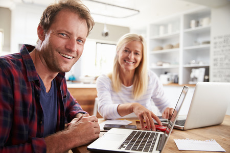home business: Man and woman working together at home