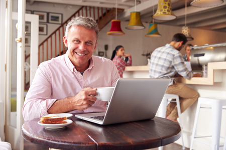 incidental people: Middle aged man working in a cafe Stock Photo