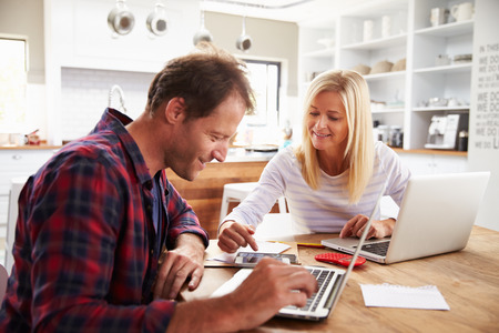 home finance: Man and woman working together at home