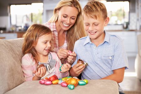 Mother celebrating Easter at home with kids photo