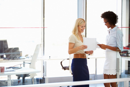two people only: Two women talking in a modern office