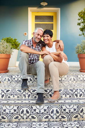 mixed couple: Mature Couple Sitting On Steps Outside House