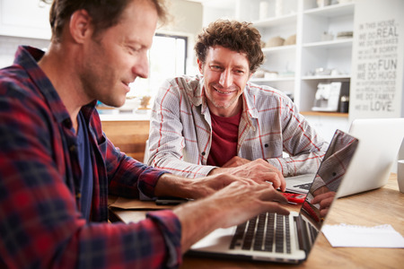 business relationship: Small business partners using computers at home Stock Photo