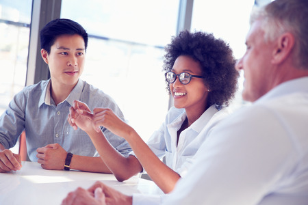 listening to people: Three business professionals working together Stock Photo