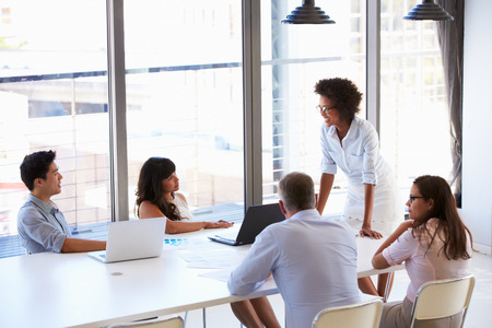 Businesswoman presenting to colleagues at a meeting Stock Photo - 41393026