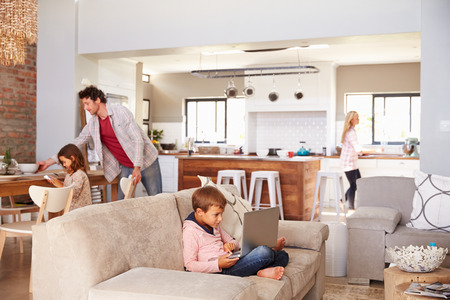 living room: Family spending time together at home Stock Photo