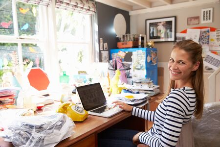 work from home: Woman On Laptop Running Business From Home Office