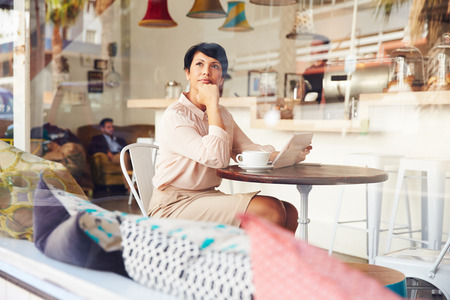 Businesswoman with digital tablet in a coffee shop Stok Fotoğraf