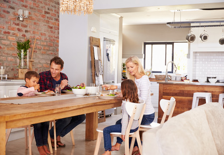 family indoors: Family mealtime at home