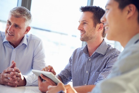Three business professionals working together Stock Photo