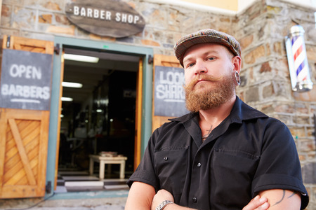 barber: Portrait Of Hipster Barber Standing Outside Shop Stock Photo