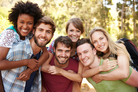 african american couple: Group Of Friends On Walk Through Countryside Together