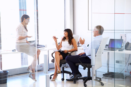 Female manager talking to colleagues in a modern office Stock Photo