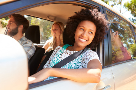 male friends: Group Of Friends In Car On Road Trip Together Stock Photo