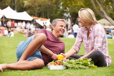 bought: Couple With Fresh Produce Bought At Outdoor Farmers Market