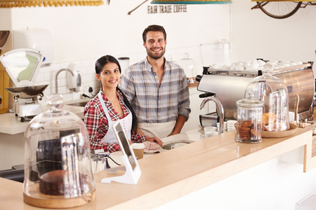 business service: Happy young cafe staff