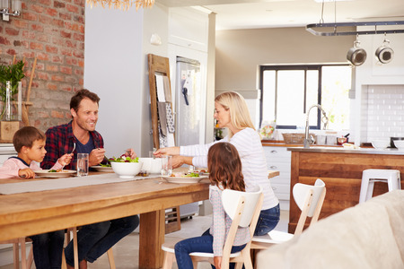 family in living room: Family mealtime at home