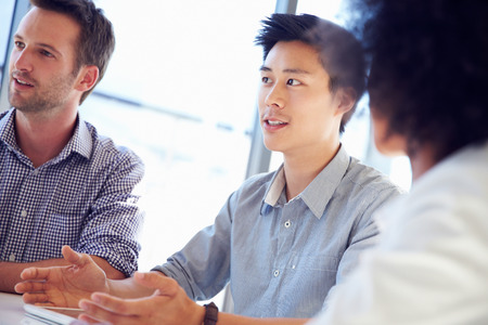 asian american: Three business professionals working together Stock Photo
