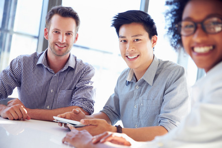Three business professionals working together. Stock Photo