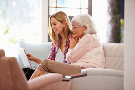 grandmother: Adult Granddaughter Helping Grandmother With Computer Stock Photo