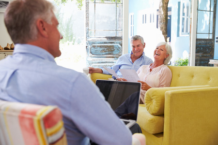 Senior Couple At Home Meeting With Financial Advisor photo