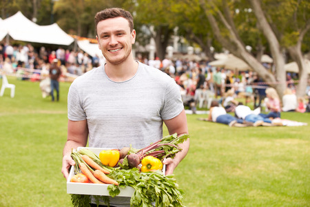 bought: Man With Fresh Produce Bought At Outdoor Farmers Market