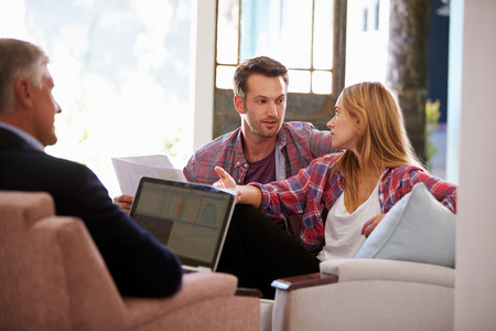 financial advisor: Couple At Home Meeting With Financial Advisor