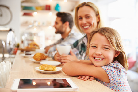 small child: Woman with child in cafe Stock Photo