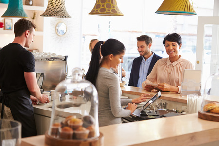 Cashier taking an order in cafe photo