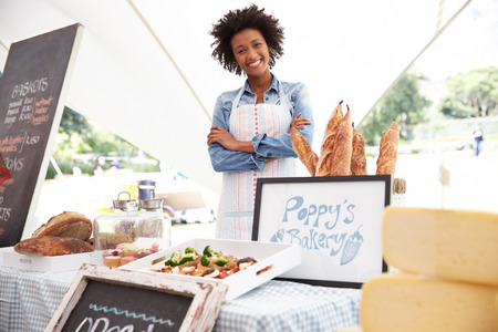 african business: Female Bakery Stall Holder At Farmers Fresh Food Market