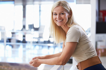Portrait of woman in office Stock Photo