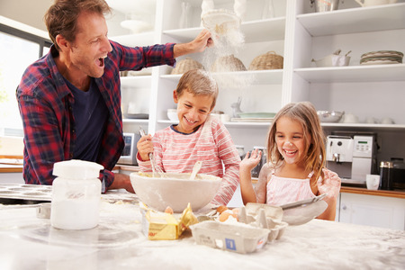 family with three children: Father baking with children Stock Photo