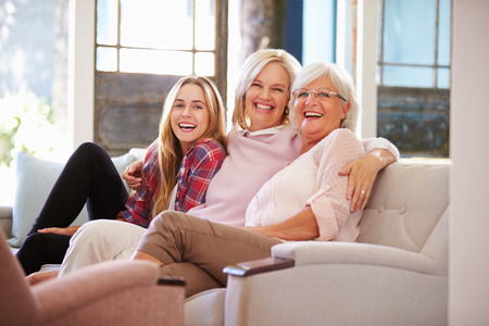 adults offspring: Grandmother With Mother And Adult Daughter Relaxing On Sofa