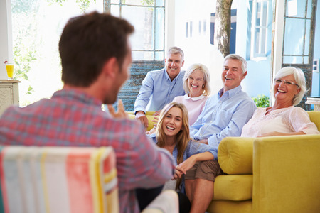 adult offspring: Extended Family Group At Home Relaxing In Lounge Stock Photo