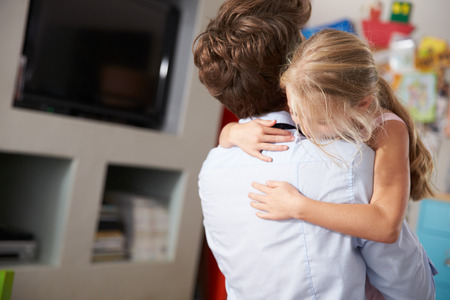 Daughter Hugging Father Returning From Work