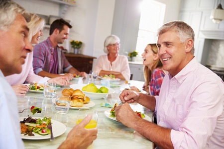 Group Of Friends Enjoying Meal At Home Together photo