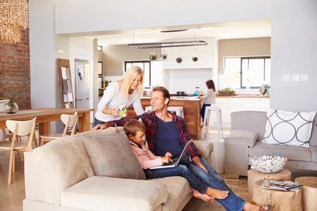 people sitting: Family spending time together at home Stock Photo