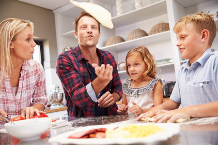 girl home: Family making pizza together