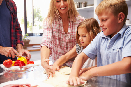 Family making pizza together photo