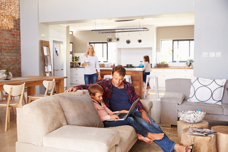 family in living room: Family spending time together at home Stock Photo