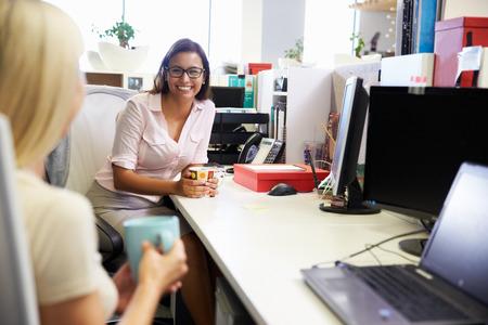 Two women having a coffee break at work photo