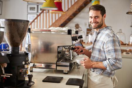 incidental people: Barista at work in a cafe