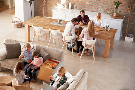 home furniture: Two families spending time together at home