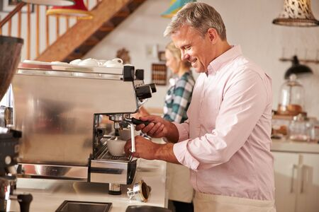 incidental people: Cafe owners at work Stock Photo