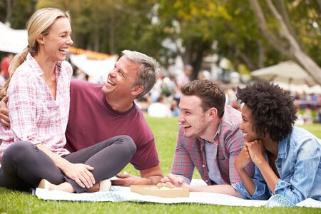 boyfriends: Older Family Relaxing At Outdoor Summer Event