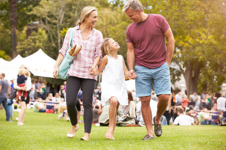 fete: Family Relaxing At Outdoor Summer Event