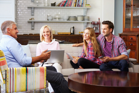 family home: Parents With Adult Offspring Using Digital Devices At Home