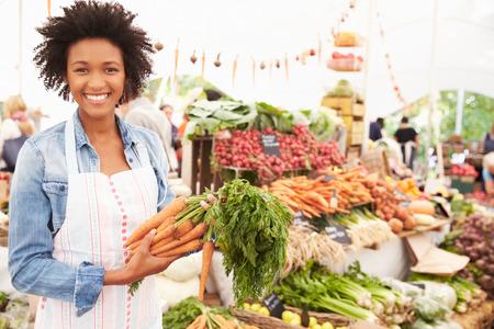 Female Stall Holder At Farmers Fresh Food Market